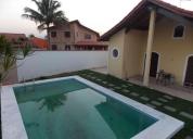 Excelente casa térrea c/ piscina à 700 mt da praia