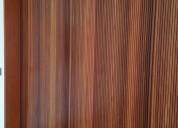 Revestimentos e painÉis ripados em madeira de lei